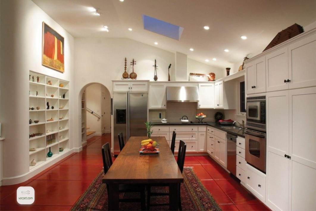 Kitchen floor decorated with bright red tiles.